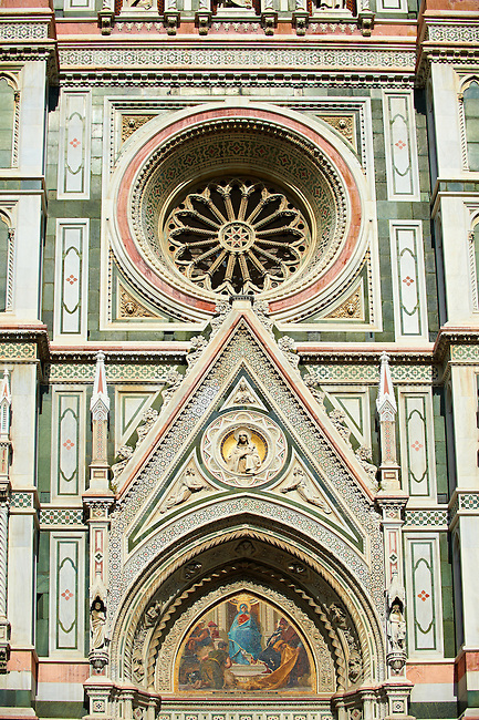 The right door mosaic and the fine Gothic architectural detail and Rose window of  the  of the Gothic-Renaissance Duomo of Florence,  Basilica of Saint Mary of the Flower; Firenza ( Basilica di Santa Maria del Fiore ).  Built between 1293 & 1436. Italy