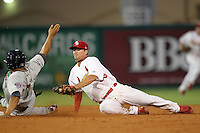 Palm Beach Cardinals second baseman Neal Pritchard #35 attempts to tag out Anderson Hidalgo #7 during a game against the Fort Myers Miracle at Roger Dean Stadium on May 1, 2012 in Jupiter, Florida.  Palm Beach defeated Fort Myers 9-3.  (Mike Janes/Four Seam Images)