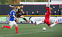 Alloa's Liam Buchanan (19) scores their first goal.