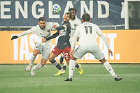 FOXBOROUGH, MA - NOVEMBER 1: Junior Moreno #5 of DC United and Carles Gil #22 of New England Revolution battle for the ball during a game between D.C. United and New England Revolution at Gillette Stadium on November 1, 2020 in Foxborough, Massachusetts.