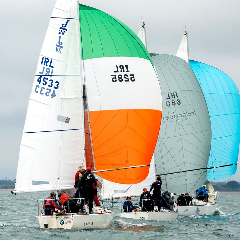Anyone who complains that the mainsail number and the spinnaker number on Crazy Horse (Luke McBride, Lough Swilly YC) don't match, and that the blue spinnaker on Scandal (Isobel Cahill, Howth YC) doesn't seem to gave a number at all, is missing the point of the contemporary J/24 Class in Ireland. Photo: Annraoi Blaney