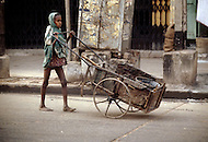 Child pushing a cart in Cairo, Egypt  - Child labor as seen around the world between 1979 and 1980 - Photographer Jean Pierre Laffont, touched by the suffering of child workers, chronicled their plight in 12 countries over the course of one year.  Laffont was awarded The World Press Award and Madeline Ross Award among many others for his work.