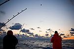 Two fisherman fishing for blue fin tuna on the Gulf of St. Lawrence near North Rustico, Prince Edward, Island, Canada.
