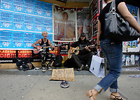 """Toronto (ON) CANADA,  April , 2008-<br /> <br /> <br /> Street Musicians playing (Social Distorsion's version of ) Johhny Cash """"Ring of Fire' on Queen street."""