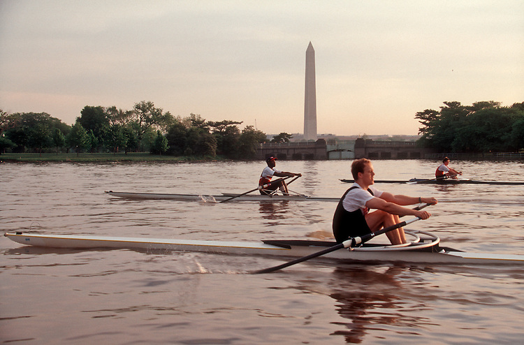 Rowing, Washington DC, Potomac Boat Club single scullers in sinlge racing shells, passing the Washington Monument on the Potomac River, .