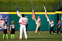 Oscar Taveras (25) of the Springfield Cardinals stands with young ball players as the color guard displays the colors during a game against the Northwest Arkansas Naturals at Hammons Field on June 14, 2012 in Springfield, Missouri. (David Welker/Four Seam Images)