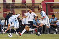 United States forward Landon Donovan (10) is defended by Argentina midfielder Fernando Gago (5) and defender Gabriel Heinze (6). The men's national teams of the United States and Argentina played to a 0-0 tie during an international friendly at Giants Stadium in East Rutherford, NJ, on June 8, 2008.