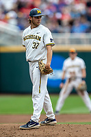 Michigan Wolverines pitcher Karl Kauffmann (37) looks towards first base during Game 1 of the NCAA College World Series against the Texas Tech Red Raiders on June 15, 2019 at TD Ameritrade Park in Omaha, Nebraska. Michigan defeated Texas Tech 5-3. (Andrew Woolley/Four Seam Images)