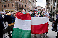 """Italian/Polish fans at the race start in Perugia<br /> <br /> 104th Giro d'Italia 2021 (2.UWT)<br /> Stage 11 from Perugia to Montalcino (162km)<br /> """"the Strade Bianche stage""""<br /> <br /> ©kramon"""