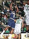 Florida International University Panthers guard Marvin Roberts (11) goes for a rebound and knocks North Texas Mean Green guard Shannon Shorter (21) down in the NCAA  basketball game between the Florida International University Panthers and the University of North Texas Mean Green at the North Texas Coliseum,the Super Pit, in Denton, Texas. UNT defeated FIU 87 to 77