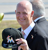MIAMI, FL - FEBRUARY 25: Florida Governor Rick Scott greets U.S. President Barack Obama on Air Force One with a Florida Marlins cap at Miami International Airport on February 25, 2015 in Miami, Florida<br /> <br /> People:  Florida Governor Rick Scott