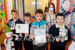 Lisselton NS students writing Christmas cards to the people in Ballydonoghue. L to r: Odhran Barrett, Shay Fennell, Finan Mason, Eoghan Horgan and Finola Fogerty (Teacher).