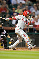 Philadelphia Phillies third baseman Michael Martinez #19 follows through during the Major League Baseball game against the Houston Astros at Minute Maid Park in Houston, Texas on September 12, 2011. Houston defeated Philadelphia 5-1.  (Andrew Woolley/Four Seam Images)