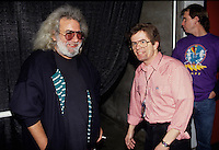 """Jerry Garcia of The Grateful Dead talks backstage with band publicist Dennis McNally before a concert in Oakland. The remaining members of the band will reunite for the final time for the """"Fare Thee Well"""" concerts  over July 4th weekend in 2015."""