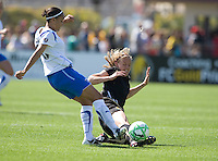 Carrie Drew slides for a ball in front of Angela Hucles, left. FC Gold Pride defeated the Boston Breakers 2-1 at Buck Shaw Stadium in Santa Clara, California on April 5th, 2009.