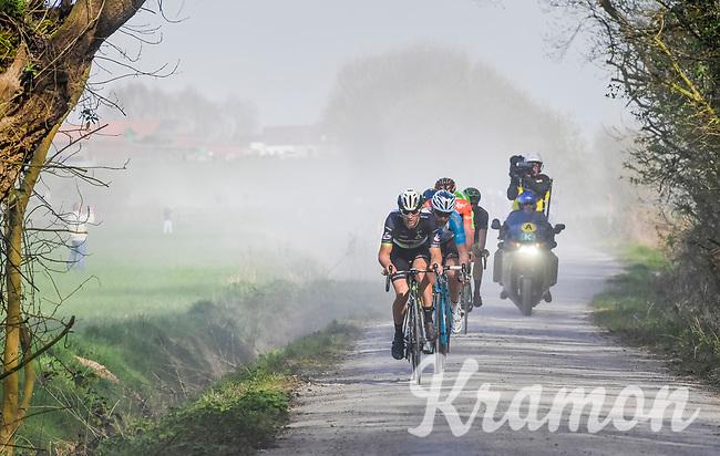 breakaway group led by Jay Robert Thomson (ZAF/Dimension Data) over the gravel of the 'Plugstreets'<br /> <br /> 79th Gent-Wevelgem 2017 (1.UWT)<br /> 1day race: Deinze › Wevelgem - BEL (249km)