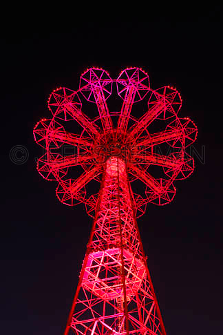 THIS IMAGE IS AVAILABLE EXCLUSIVELY FROM GETTY IMAGES<br /> <br /> PLEASE SEARCH FOR IMAGE # sb10069646b-001 ON WWW.GETTYIMAGES.COM<br /> <br /> Upward View of the Parachute Jump (landmarked former amusement park ride) on the Boardwalk at Coney Island, illuminated at night.....Coney Island, Brooklyn, New York City, New York State