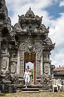 Jatiluwih, Bali, Indonesia.  Women Bringing Offerings into Inner Courtyard,  Luhur Bhujangga Waisnawa Hindu Temple.