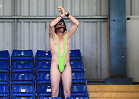 Last away day of the season often means a supporter will wear a fancy dress outfit. A Wycombe fan dons a Sacha Baron Cohen Mankini at Bury. Luckily the sun was shining and the temperature warm as he cheers on his team  during Bury vs Wycombe Wanderers, NPower League Two Football at Gigg Lane on 30th April 2011