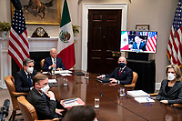 United States President Joe Biden participates in a virtual bilateral meeting with President Andrés Manuel López Obrador of Mexico in the Roosevelt Room of the White House in Washington on March 1st, 2021.  From left to right: US National Security Advisor Jake Sullivan, US Secretary of State Antony Blinken, President Biden, US Secretary of Homeland Security Alejandro Mayorkas, and Elizabeth Sherwood-Randall, Deputy National Security Advisor for Homeland Security.<br /> Credit: Anna Moneymaker / Pool via CNP /MediaPunch