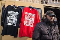 """Am Samstag den 31. Januar 2015 versammelten sich auf dem Staromestske Namesti-Platz (Alststaetter Markt / Old Town Square) in Prag ca. 500 Anhaenger der Pegida-Bewegung. Wie in Deutschland sind die Pegida (Patriotische Europaere gegen die Islamisierung des Abendlandes) Neonazis, Hooligans, Islamsfeinde und sog. """"Besorgte Buerger"""".<br /> Gegen die Pegida-Kundgebung protestierten Vertreter verschiedener Religionen, Antifaschisten, Sinti und Roma mit einem Gottesdienst, Gesaengen und Plakaten und Schildern, auf denen sich zum Teil ueber die Islamophobie der Pegida-Anhaenger lustig gemacht wurde. Beide Veranstaltungen fanden gleichzeitig nebeneinander auf dem Platz statt. Aus der Pegida-Kundgebung kamen immer wieder heftige Beschimpfungen und Neonazis versuchten Gegendemonstranten ein Transparent zu entreissen.<br /> Im Bild: Bei der Kundgebung wurden T-Shirts mit rassistischen Aufdrucken verkauft.<br /> 31.1.2015, Prag<br /> Copyright: Christian-Ditsch.de<br /> [Inhaltsveraendernde Manipulation des Fotos nur nach ausdruecklicher Genehmigung des Fotografen. Vereinbarungen ueber Abtretung von Persoenlichkeitsrechten/Model Release der abgebildeten Person/Personen liegen nicht vor. NO MODEL RELEASE! Nur fuer Redaktionelle Zwecke. Don't publish without copyright Christian-Ditsch.de, Veroeffentlichung nur mit Fotografennennung, sowie gegen Honorar, MwSt. und Beleg. Konto: I N G - D i B a, IBAN DE58500105175400192269, BIC INGDDEFFXXX, Kontakt: post@christian-ditsch.de<br /> Bei der Bearbeitung der Dateiinformationen darf die Urheberkennzeichnung in den EXIF- und  IPTC-Daten nicht entfernt werden, diese sind in digitalen Medien nach §95c UrhG rechtlich geschuetzt. Der Urhebervermerk wird gemaess §13 UrhG verlangt.]"""