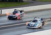 Jun. 16, 2012; Bristol, TN, USA: NHRA funny car driver Tim Wilkerson (near lane) races alongside Blake Alexander during qualifying for the Thunder Valley Nationals at Bristol Dragway. Mandatory Credit: Mark J. Rebilas-