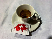 Switzerland. Canton Ticino. Lugano. Restaurant. Empty coffee cup with a sugar sachet. A map of Switzerland with a white cross. 25.01.2019 © 2019 Didier Ruef