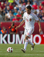 Spain midfielder Sergio Busquets (16) dribbles. In a friendly match, Spain defeated USA, 4-0, at Gillette Stadium on June 4, 2011.