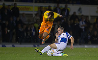 Mark McChrystal of Bristol Rovers tackles Aaron Holloway of Wycombe Wanderers during the Johnstone's Paint Trophy match between Bristol Rovers and Wycombe Wanderers at the Memorial Stadium, Bristol, England on 6 October 2015. Photo by Andy Rowland.