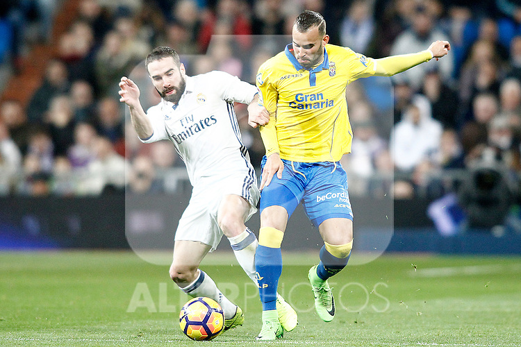 Real Madrid's Daniel Carvajal (l) and UD Las Palmas' Jese Rodriguez during La Liga match. March 1,2017. (ALTERPHOTOS/Acero)