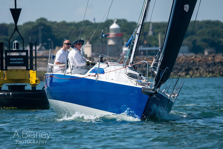 Former winner Checkmate XV (Dave Cullen and Aidan Beggan) gathers speed as she gets into open water. Photo: Annraoi Blaney