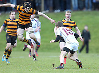 RBAI vs R S ARMAGH | Saturday 21st February 2015<br /> <br /> Charlie Fryers jumps with pain as he injures his ankle during 2015 Ulster Schools Cup Quarter-Final between RBAI and Royal School Armagh at Osborne Park, Belfast, Northern Ireland.<br /> <br /> Picture credit: John Dickson / DICKSONDIGITAL