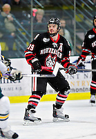 26 November 2010: Northeastern University Huskies' forward Wade MacLeod, a Senior from Coquitlam, British Columbia, in action against the University of Vermont Catamounts at Gutterson Fieldhouse in Burlington, Vermont. The Huskies came back from a 2-0 deficit to earn a 2-2 tie against the Catamounts. Mandatory Credit: Ed Wolfstein Photo