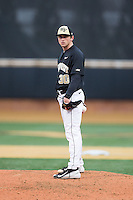 Wake Forest Demon Deacons relief pitcher Connor Johnstone (30) looks to his catcher for the sign against the Appalachian State Mountaineers at Wake Forest Baseball Park on February 13, 2015 in Winston-Salem, North Carolina.  The Mountaineers defeated the Demon Deacons 10-1.  (Brian Westerholt/Four Seam Images)