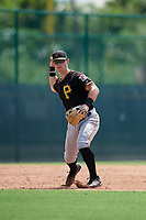 Pittsburgh Pirates third baseman Patrick Dorrian (67) throws to first base during a Florida Instructional League game against the Detroit Tigers on October 2, 2018 at the Pirate City in Bradenton, Florida.  (Mike Janes/Four Seam Images)