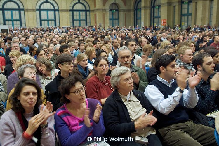 Delegates applaud a Palestinian speaker at the European Social Forum in Alexandra Palace, London