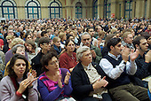 Delegates applaud a Palestinian speaker at the European Social Forum in Alexandra Palace, London
