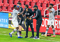 WASHINGTON, DC - NOVEMBER 8: Zachary Brault-Guillard #15 of the Montreal Impact celebrates with Thierry Henry during a game between Montreal Impact and D.C. United at Audi Field on November 8, 2020 in Washington, DC.
