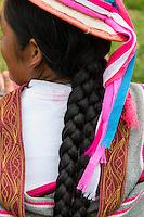 Peru, Urubamba Valley, Quechua Village of Misminay.  Quechua Woman with Pigtails.