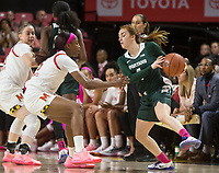 COLLEGE PARK, MD - FEBRUARY 03: Taryn McCutcheon #4 of Michigan State holds the ball away from Kaila Charles #5 of Maryland during a game between Michigan State and Maryland at Xfinity Center on February 03, 2020 in College Park, Maryland.