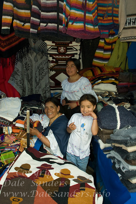 Three generations of women sell their weaving at a crafts market in the capital city of Quito, Equador.