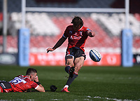 24th April 2021; Kingsholm Stadium, Gloucester, Gloucestershire, England; English Premiership Rugby, Gloucester versus Newcastle Falcons; Lloyd Evans of Gloucester kicks a conversion while Kyle Moyle of Gloucester stabilises the ball in the wind