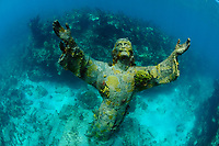 Christ of the Abyss is a 8 1/2 foot, 4,000 pound bronze sculpture of Jesus Christ that stands in 25 feet of water off of Key Largo, Florida, United States. It is located near Dry Rocks, about six miles east-northeast of the Key Largo Cut, in the John Pennekamp Coral Reef State Park.