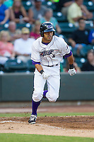 Keenyn Walker (4) of the Winston-Salem Dash hustles down the first base line against the Carolina Mudcats at BB&T Ballpark on June 6, 2014 in Winston-Salem, North Carolina.  The Mudcats defeated the Dash 3-1.  (Brian Westerholt/Four Seam Images)