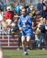 Duke University attacker Makenzie Hommel (2) brings the ball forward. Boston College (white) defeated Duke University (blue), 10-9, on the Newton Campus Lacrosse Field at Boston College, on April 6, 2013.