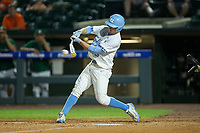 Brian Miller (5) of the North Carolina Tar Heels makes contact with the baseball during the game against the Miami Hurricanes in the second semifinal of the 2017 ACC Baseball Championship at Louisville Slugger Field on May 27, 2017 in Louisville, Kentucky.  The Tar Heels defeated the Hurricanes 12-4.  (Brian Westerholt/Four Seam Images)