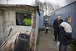 Glossop North End 0 Barnoldswick Town 1, 19/02/2011. Surrey Street, North West Counties League Premier Division. The turnstile operator talking to a spectator as he pays his way into Glossop North End's Surrey Street ground before the club's game with Barnoldswick Town in the Vodkat North West Counties League premier division. The visitors won the match by one goal to nil watched by a crowd of 203 spectators. Glossop North End celebrated their 125th anniversary in 2011 and were once members of the Football League in England, spending one season in the top division in 1899-00. Photo by Colin McPherson.