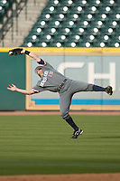 Center fielder Zak Presley #15 of the Houston Cougars makes an acrobatic catch as the wind blew the ball behind him versus the Baylor Bears  in the 2009 Houston College Classic at Minute Maid Park February 27, 2009 in Houston, TX.  The Bears defeated the Cougars 3-2. (Photo by Brian Westerholt / Four Seam Images)