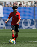 GRENOBLE, FRANCE - JUNE 12: Soyun Ji #10 of the Korean National Team looks to pass during a game between Korea Republic and Nigeria at Stade des Alpes on June 12, 2019 in Grenoble, France.