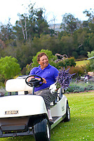 Aliíi Chang, agricultural artist, horticulturalist and owner of Alii Kula Lavender farm at the base of Haleakala, Kula, in his mini-cart with a bouquet of lavender flowers